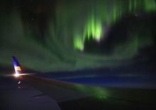 Icelandair flight over the North Atlantic with Aurora Boralis over wing