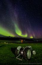 Aurora borealis over farmland in northern Iceland