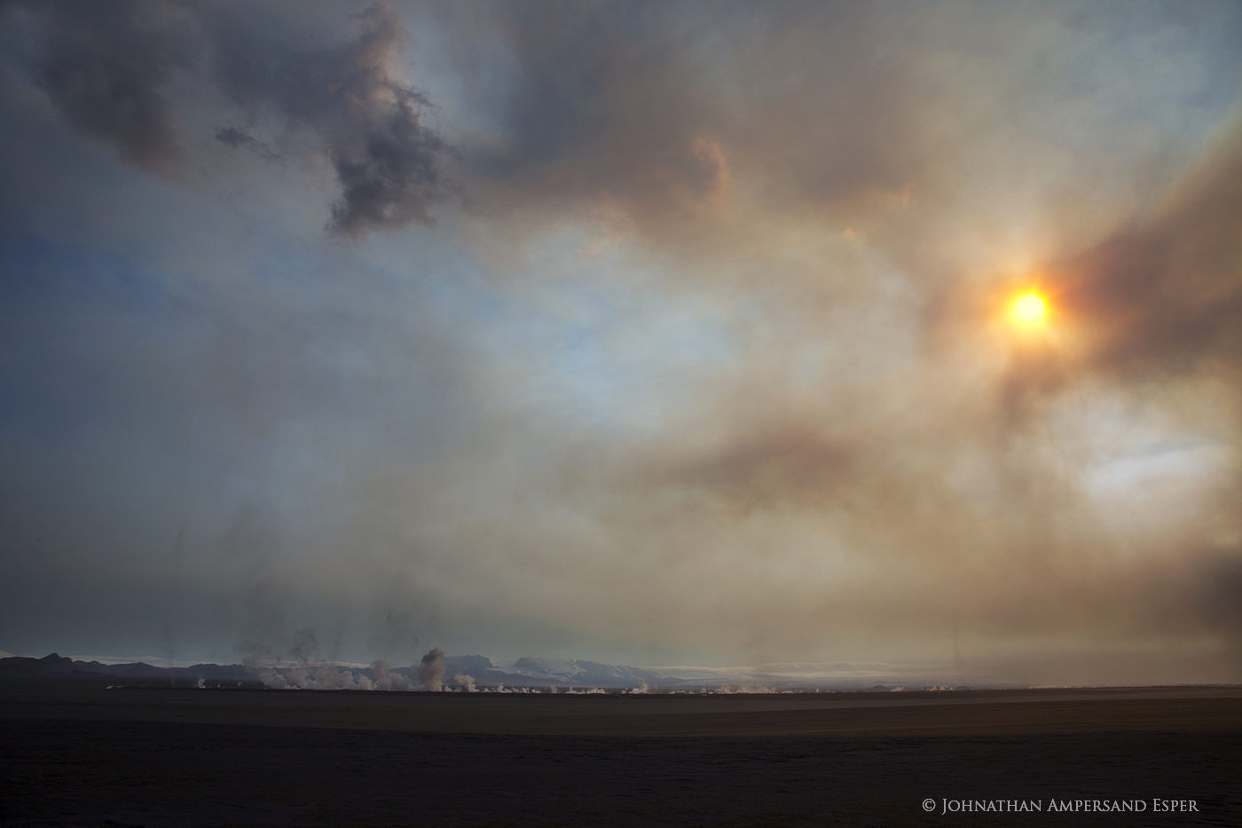 The sun filtering through toxic gas clouds from the Holuhraun volcanic eruption.