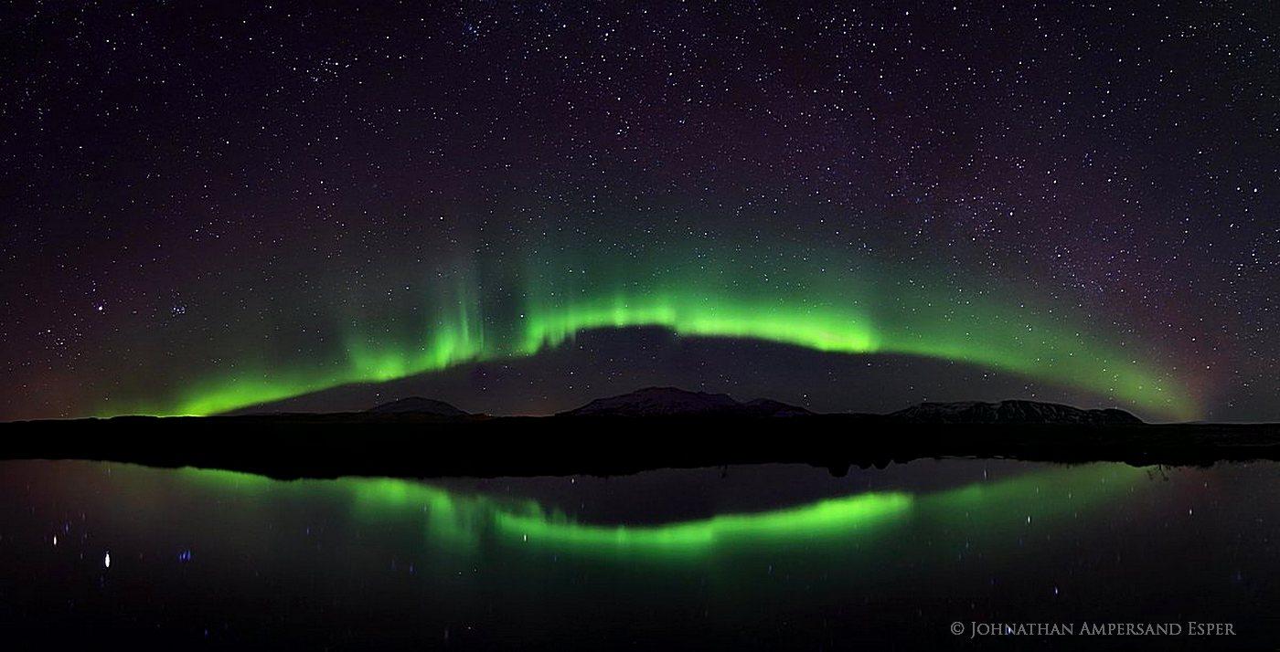 Aurora borealis display reflecting in Silfra tectonic plate crack, Þingvellir National Park, Iceland
